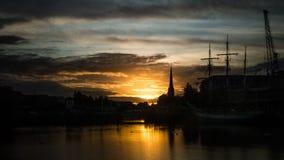 Sunrise in Bristol - harbour. ENGLAND, BRISTOL - 13 SEP 2015: Sunrise in Bristol, harbour, golden hour Stock Photo