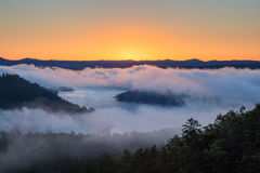 Sunrise at Broken Bow Lake. The sun rises on a foggy morning at Broken Bow Lake in Oklahoma, USA Stock Images