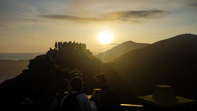 Sunrise in Bromo. Unidentified tourists visit at Mount Bromo on June 22, 2015 in Java, Indonesia. Mount Bromo is one of the most visited tourist attractions Royalty Free Stock Photos