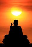 Sunrise and Buddha Royalty Free Stock Photography
