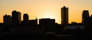 Sunrise Buildings Downtown City Skyline Knoxville Tennessee Unit. Knoxville city skyline is backlit by the orange hues of sunrise Stock Images