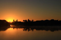 Sunrise between buildings of Surfers Paradise from the lake stock images