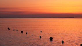 Sunrise and buoys Royalty Free Stock Photos