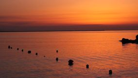Sunrise and buoys Royalty Free Stock Photo