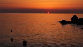 Sunrise and buoys stock footage