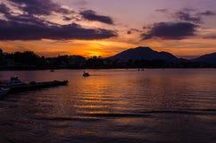 Sunrise on a calm lake Stock Photos