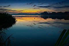 Sunrise at calm reservoir Stock Images