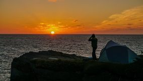 Sunrise camp at the Berry head arch in Newfoundland, Canada. royalty free stock photo