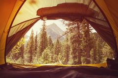 Sunrise at campsite seen from inside tent. Overlooking the beautiful mountain landscape in the Altai mountains in Siberia. Instagram filter stock image