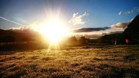 Sunrise On the Campsite. Sunshine across the grass, campsite Ogwen Valley stock image