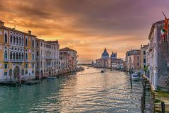 Sunrise at the Canale Grande in Venice. With the basilica Santa Maria della Salute in the background stock photography