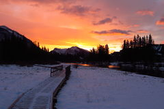 Sunrise on Canmore River Stock Images