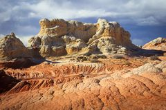 Colorful patterned sandstone scene in the desert southwest, Utah, USA. Sunrise canyon cliffs glowing in the desert southwest landscape, Utah, USA Royalty Free Stock Image