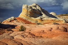 Colorful patterned sandstone scene in the desert southwest, Utah, USA. Sunrise canyon cliffs glowing in the desert southwest landscape, Utah, USA Royalty Free Stock Images