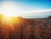Sunrise in the canyon. Rays of the sun and man Royalty Free Stock Image