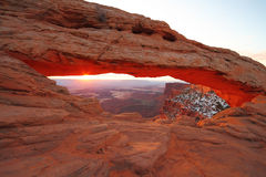 Sunrise in Canyonlands National Park. The Beautiful Orange Glow of the Sunrise at Mesa Arch in Canyonlands National Park near Moab, Utah, USA Royalty Free Stock Photo
