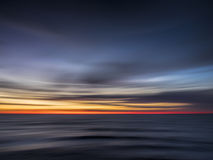 Sunrise at Cape May, New Jersey. Abstract of dawn breaking over the Atlantic Ocean at Cape May, NJ Stock Photography