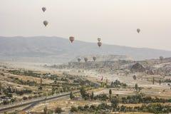 Sunrise in cappadocia with air baloons. Air baloons above Cappadocia landscape an sunrise Stock Photography