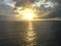 Sunrise in the caribe sea. Water, sky, clouds sun stock image