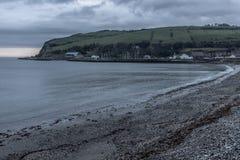 Sunrise in Carnlough bay. Antrim, Northern Ireland, UK royalty free stock photos