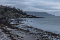 Sunrise in Carnlough bay. Antrim, Northern Ireland, UK royalty free stock photography