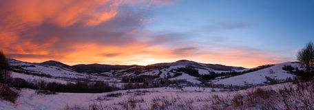 Sunrise Carpathian mountain winter panorama. Royalty Free Stock Images
