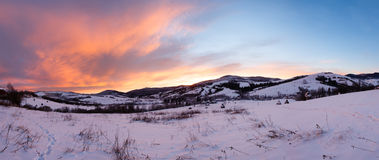 Sunrise Carpathian mountain winter panorama. Royalty Free Stock Photography