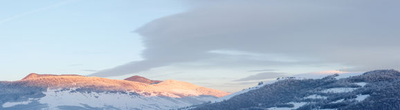 Sunrise Carpathian mountain winter panorama. Stock Photos