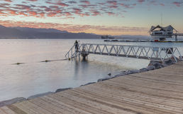 Sunrise at central public beach of Eilat - famous resort city in Israel Royalty Free Stock Photo