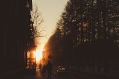 Sunrise on the central street of the small town royalty free stock image