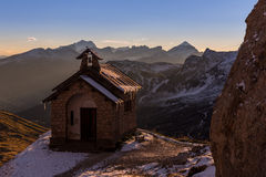 Sunrise at chapel Passo Pordoi in Dolomites in Italy stock image