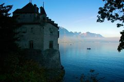 Sunrise at Chateau Chillon. The colorful mist of a sunset lingers over Lake Geneva as Chateau Chillon looms in the foreground Royalty Free Stock Photos