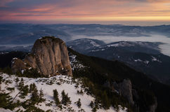 Sunrise in cheahlau mountains in winter time. NRomanian National Park Stock Photo