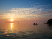 Sunrise on the Chesapeake Bay. Coast with crab boat and sail boats Stock Images