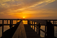 Sunrise on the Chesapeake Bay, Havre de Grace, MD. Colorful sunrise with dock and clouds Royalty Free Stock Photo