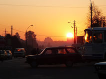 Sunrise in city. In the morning on a crossroads Stock Photos