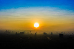 Sunrise In The City With building Silhouettes Stock Photo
