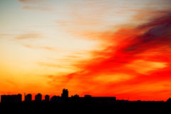 Sunrise in city landscape. Urban sunset. Rays of the sun above t Royalty Free Stock Images