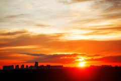 Sunrise in city landscape. Urban sunset. Rays of the sun above t Royalty Free Stock Photo