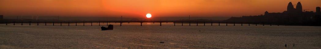 Sunrise city panorama. Panorama cityscape Dnipro river and bridge on sunrise Royalty Free Stock Photography