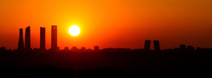 Sunrise city silhouette. Sunrise business tower silhouette in Madrid Royalty Free Stock Photography