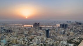 Sunrise with Cityscape of Ajman from rooftop timelapse. Ajman is the capital of the emirate of Ajman in the United Arab Emirates. 4K stock images
