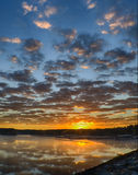 Sunrise with clearing storm clouds Royalty Free Stock Photos