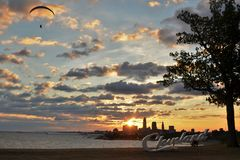 Sunrise with Cleveland skyline, Lake Erie, and paraglider Stock Images