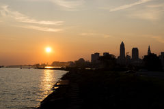 Sunrise in Cleveland. The sun low in the eastern sky just after sunrise. Depicted are a portion of the Port of Cleveland on Lake Erie, and the downtown city royalty free stock image