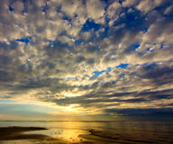 Sunrise with cloud pattern Stock Photo