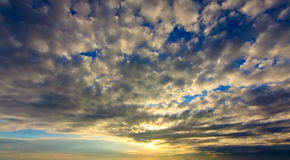 Sunrise with cloud pattern Stock Images
