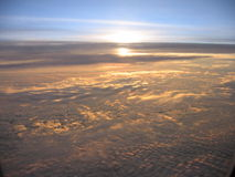 Sunrise in the clouds. Taken from an airplan 30 000 feet in the air Stock Image