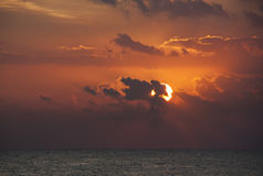 Sunrise in clouds above sea Royalty Free Stock Photo