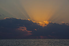 Sunrise in clouds above sea Royalty Free Stock Images